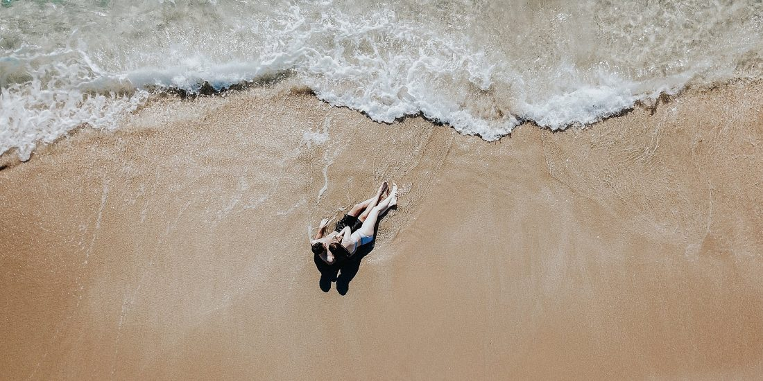 Romantic beach engagement drone photography