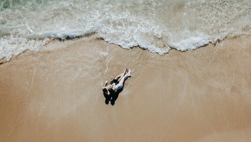 Romantic beach engagement drone photography