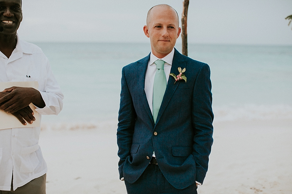 Emotional groom seeing his bride for the first time