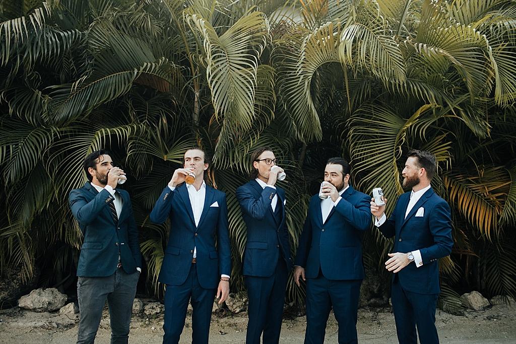 groomsmen drinking beers in the florida keys