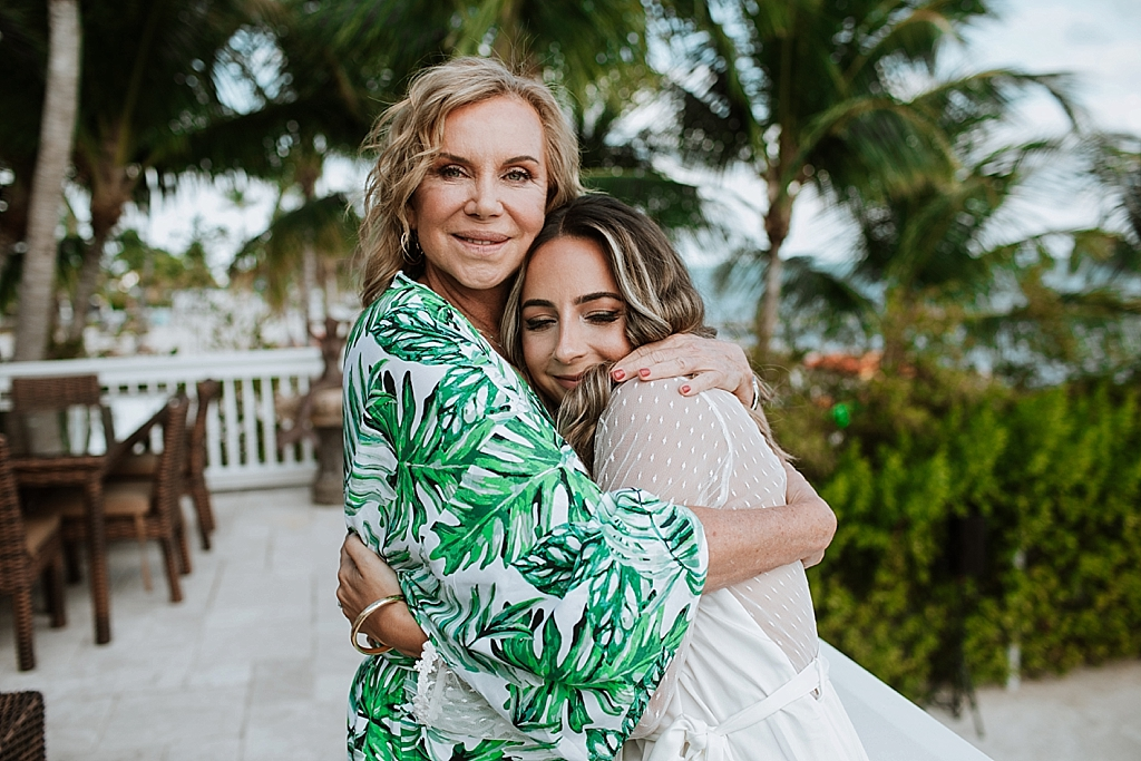 bride and her mom embracing on the brides wedding day