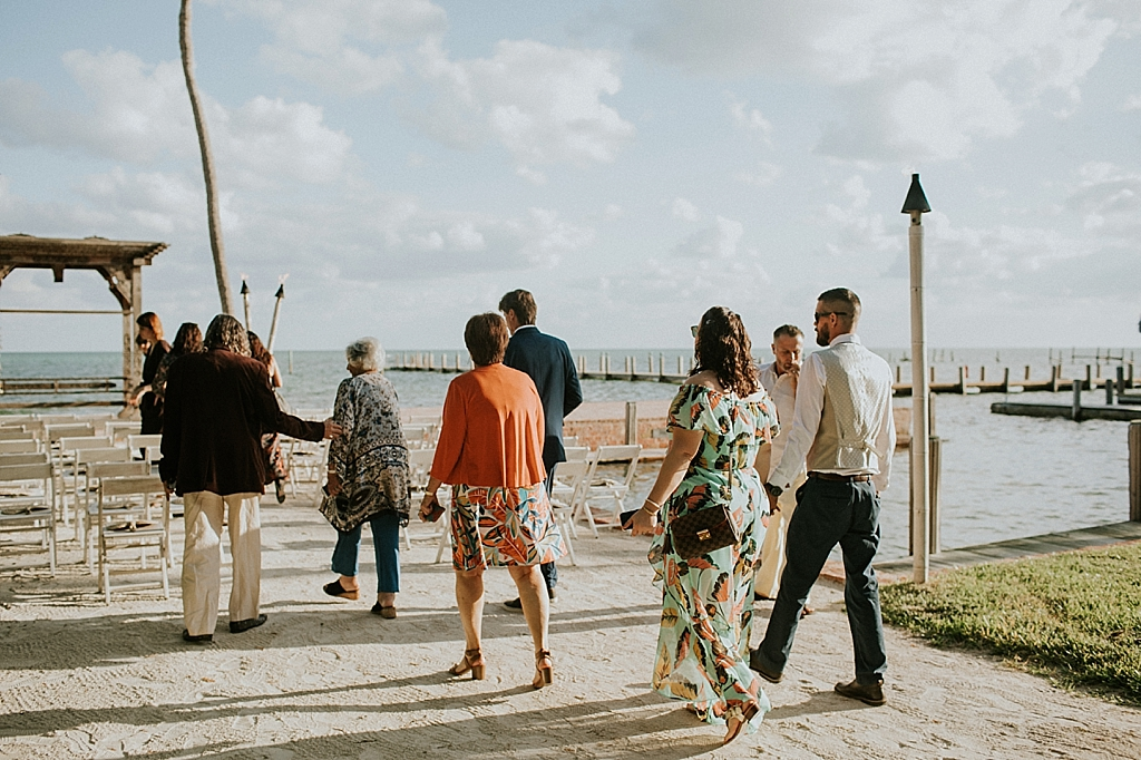 guests heading to a beachside florida keys wedding